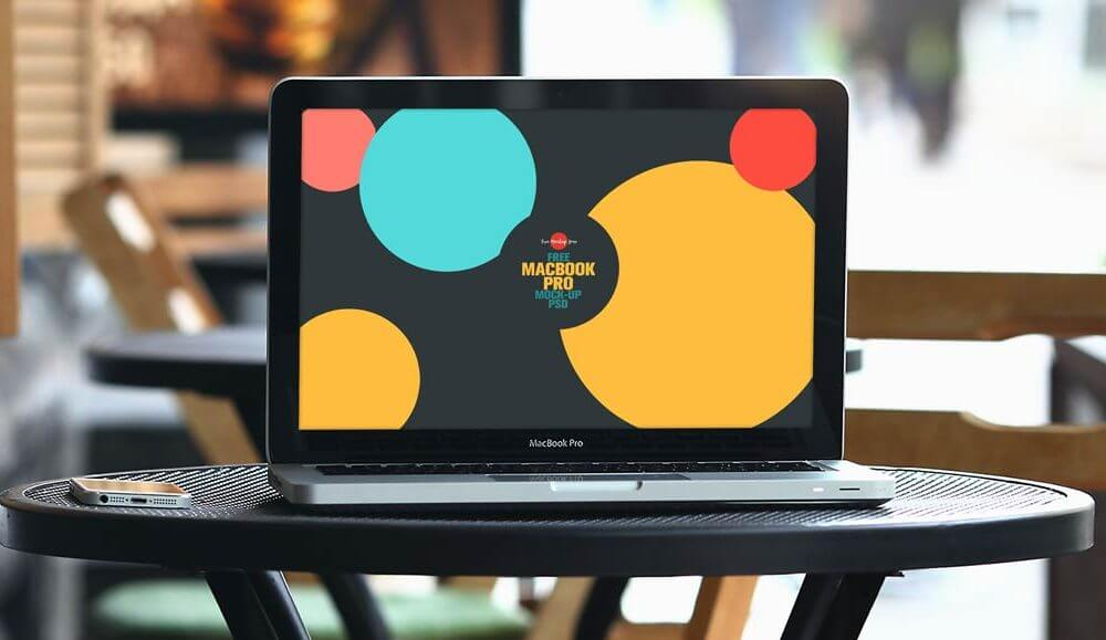 MacBook Pro on Restaurant Table Mockup